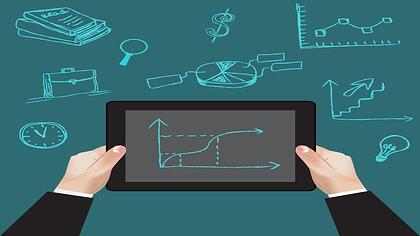 Tablet showing real estate performance for october
